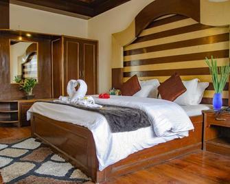 Hotel Abhinandan - Mussoorie - Bedroom