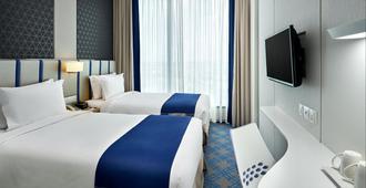 Holiday Inn Express Singapore Katong - Singapore - חדר שינה