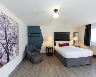 SureStay Hotel by Best Western Castlegar - Castlegar - Schlafzimmer