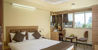 Hotel Yogi Broadway - Mumbai - Bedroom