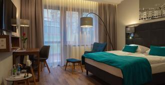هوتل توباز بوزنان سنتروم - بوزنان - غرفة نوم