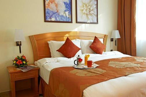 Golden Tulip Sharjah - Sharjah - Bedroom