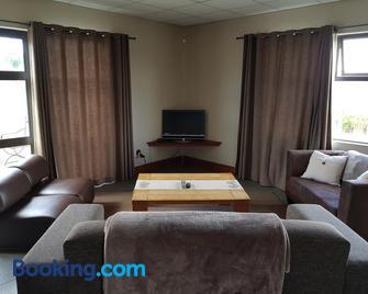 Stay@67 Apartments - Dullstroom - Dullstroom - Wohnzimmer