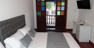 Casa Hotel Vida - กาลี - ห้องนอน