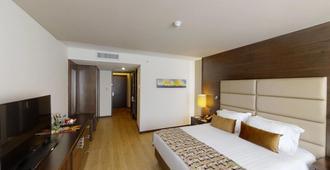 Hotel Estelar Milla De Oro - Medellín - Bedroom
