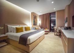 Ja Lake View Hotel - Dubái - Habitación
