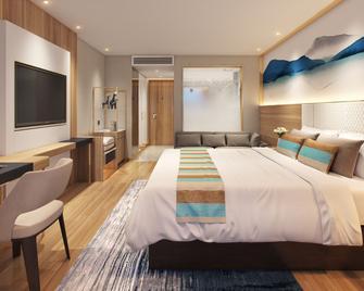 Vatica Hengshui halixun Intl Peace Hospital Hotel - Hengshui - Schlafzimmer