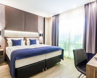 Sky Hotel Cloppenburg - Cloppenburg - Bedroom