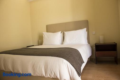 Metro Vilar Suites & Villas - Moreira - Bedroom