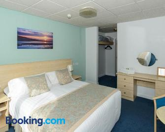 Sandown Park Lodge - Esher - Schlafzimmer