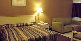 Travelodge by Wyndham Farmington - Farmington - Bedroom