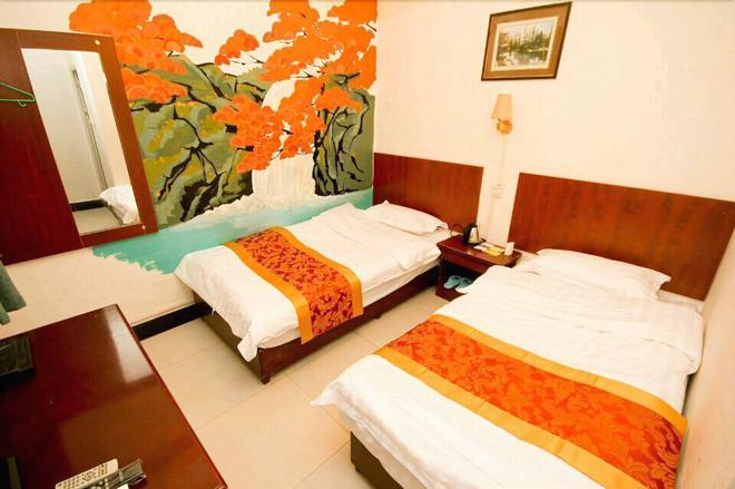 Xi'an Eastwood Inn - Xi'an - Bedroom