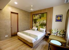 Silverador Boutique Hotel - Thane - Schlafzimmer
