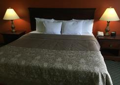 Deluxe 6 Inn & Suites - Olmito - Bedroom