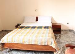 Hotel Meumi Palace - Yaoundé - Slaapkamer