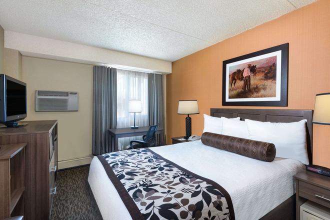 Days Inn & Suites by Wyndham Bozeman - Bozeman - Bedroom