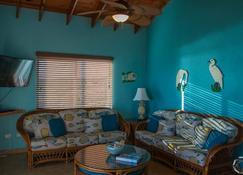 Bahama Dreamin 1bd 1ba Oceanfront Vila Includes Vehicle !! , Ac, Gas Grill - Deadman's Cay - Living room
