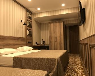 Keles Hotel - Rize - Schlafzimmer