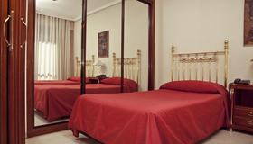 Apartamentos Olano C.B. - Madrid - Habitación