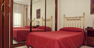Apartamentos Olano C.B. - מדריד - חדר שינה