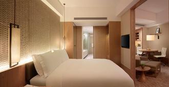 New World Shanghai Hotel - Shangai - Habitación
