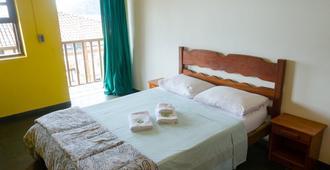 貝伊拉瑪爾青年旅舍 - Vila do Abraao - 臥室