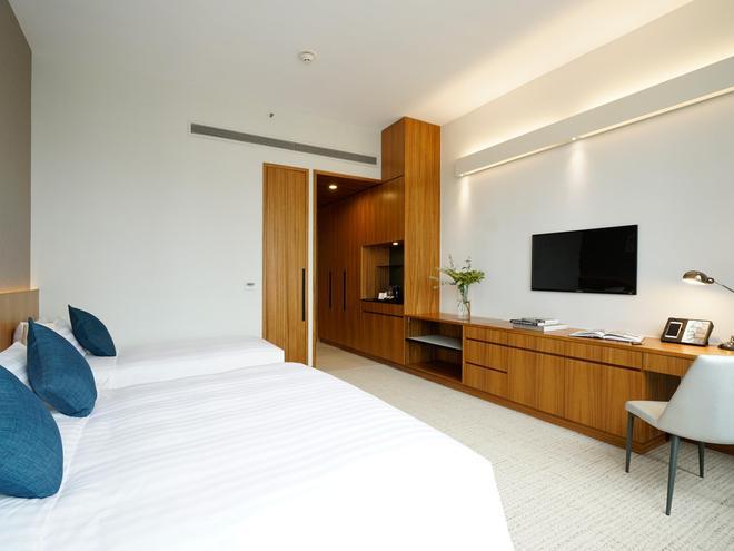 Hotel Cozi Wetland - Hong Kong - Phòng ngủ