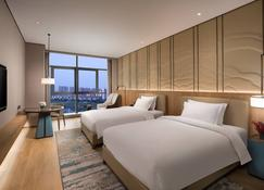 Ramada by Wyndham Hengyang Zhengxiang - Hành Dương - Phòng ngủ