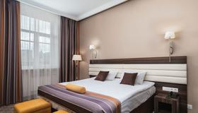 Slavyanka Hotel - Moskau - Schlafzimmer