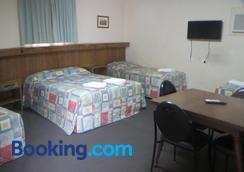 Coachman Hotel Motel - Паркс - Спальня