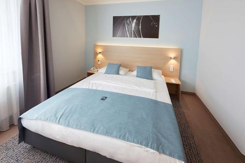 GHOTEL hotel & living Göttingen - Göttingen - Makuuhuone