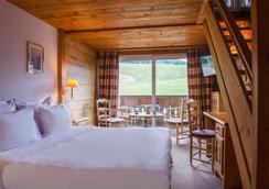 Chalet-Hôtel La Marmotte, La Tapiaz & Spa, The Originals Relais (Hotel-Chalet De Tradition) - Les Gets - Bedroom
