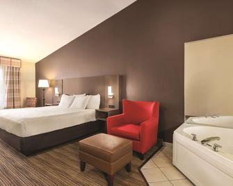 Country Inn & Suites by Radisson, Albert Lea, MN - Albert Lea - Спальня