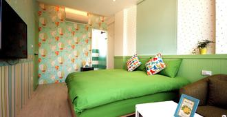 Camouflage Guest House - Luodong - Bedroom