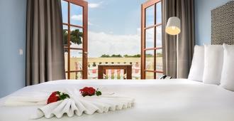 Livingstone Jan Thiel Resort - ווילמסטאד - חדר שינה