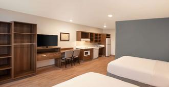 Woodspring Suites Houston 288 South Medical Center - יוסטון - חדר שינה