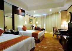 Howard Johnson by Wyndham Pearl Plaza Wuhan - Wuhan - Bedroom