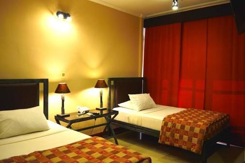 아스펜 호텔 & 아파트 - 아순시온 - 침실