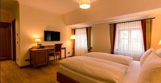 Hotel & Gaststätte zum Erdinger Weißbräu - מינכן - חדר שינה
