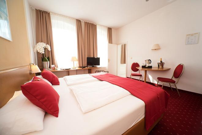 City Hotel Am Wasserturm - Halle - Κρεβατοκάμαρα