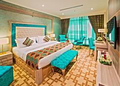 شقق و فندق سافير بارك - الدوحة - غرفة نوم