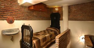 B&B Il Caravaggio - Catania - Phòng ngủ