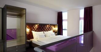 Abito Suites - Leipzig - Bedroom