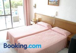 艾米克福洛雷斯酒店 - 帕爾馬灘 - 帕爾馬 - 臥室