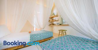 Mule Malu Tropical Stay - South Kuta - Bedroom