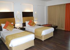 Barsana Hotel & Resort - Siliguri - Bedroom
