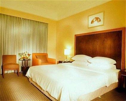 Golden Coast Lawton Hotel - Haikou - Bedroom