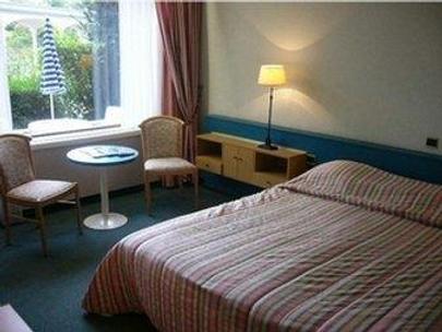 Zhengzhou Jianguo Hotel - Trịnh Châu - Phòng ngủ
