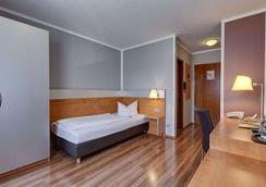 Attimo Hotel Stuttgart - Stuttgart - Bedroom