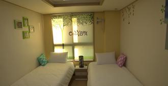 Cozybox Guesthouse - סיאול - חדר שינה